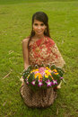 Pretty woman in Thai style clothes in posing hold flower joist. Royalty Free Stock Photo