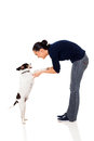 Pretty woman training pet dog isolated white background Royalty Free Stock Photos