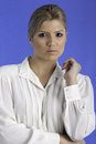 Pretty woman wearing a white shirt blue background Royalty Free Stock Photos
