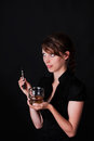 Pretty woman with whiskey and electric cigarette Stock Photos