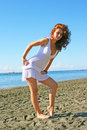 Pretty woman in white dress on beach in limassol cyprus Stock Images