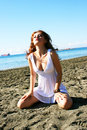 Pretty woman in white dress on beach in limassol cyprus Royalty Free Stock Photography