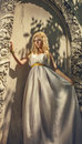 image photo : Pretty woman in white dress in the Greek style