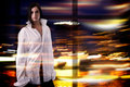Pretty woman in white shirt over colorful blurred lights background attractive brunette wearing big size is standing unfocused Royalty Free Stock Photography