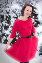 Pretty woman in winter with red dress Royalty Free Stock Photography