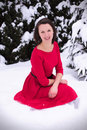 Pretty woman in winter with red dress Royalty Free Stock Photo