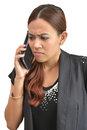 Pretty woman worried by mobile phone on white Stock Photography