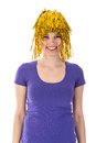 Pretty woman with yellow carnival wig over white background Stock Photography