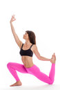 Pretty Woman in Yoga Pose - One legged KIng Pigeon Position. Royalty Free Stock Photo