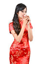 Pretty women with Chinese traditional dress Cheongsam and drinki Royalty Free Stock Photography