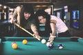 Pretty women playing billiards
