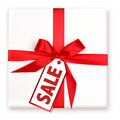 Pretty Wrapped Holiday Gift With Decorated SALE Ta Royalty Free Stock Photo