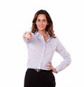 Pretty young adult in blouse pointing at you portrait of a on isolated background Royalty Free Stock Images