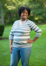 Pretty young african american female portrait outdoor smiling walking in park Stock Photography