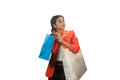 Pretty young asian business woman with shopping bags isolated on a white background Royalty Free Stock Images