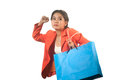Pretty young asian business woman with shopping bags isolated on a white background Stock Image