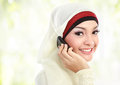Pretty young asian muslim woman while calling on the phone Stock Images