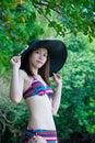 Pretty Young Asian woman in bikini relaxing on the beach Royalty Free Stock Photo