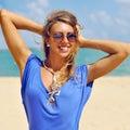 Pretty young beautiful woman having fun on the beach Royalty Free Stock Photo
