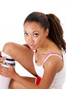 Pretty young black woman sitting exercise clothes Stock Images