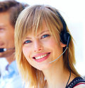 Pretty young blond executive wearing headset Royalty Free Stock Image