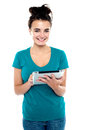 Pretty young brunette using wireless tablet device Stock Photos