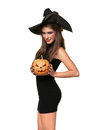 Pretty young brunette woman with a pumpkin Royalty Free Stock Photos