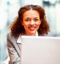 Pretty young business woman working on the laptop Royalty Free Stock Photography