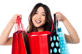 Pretty young chinese girl holding shopping bags beautiful female model over white background Royalty Free Stock Photo