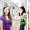 Pretty, young college student in a library Stock Images