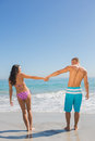 Pretty young couple having holidays together on the beach Stock Image
