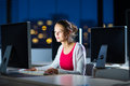 Pretty, young female college student using a desktop computer Royalty Free Stock Photo