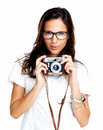 Pretty young female holding an old camera on white Stock Images