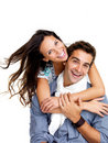 Pretty young female hugging her boyfriend on white Stock Photo