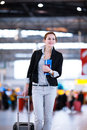 Pretty young female passenger at the airport shallow dof color toned image Stock Images