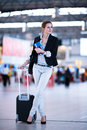 Pretty young female passenger at the airport shallow dof color toned image Stock Image