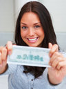 Pretty young female showing a money note Royalty Free Stock Image