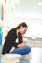 Pretty young female student sitting studying Royalty Free Stock Photo