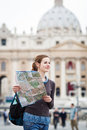 Pretty young female tourist studying a map Stock Photography