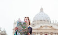 Pretty young female tourist studying a map Stock Image