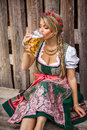 Pretty young german oktoberfest woman in a dirndl dress w blonde with beer Stock Image