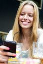 Pretty young girl chatting with  smartphone Royalty Free Stock Photo