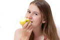 Pretty young girl eating an apple Royalty Free Stock Photos