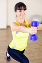 Pretty young girl fitness workout in gym Royalty Free Stock Photo