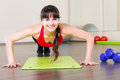 Pretty young girl fitness workout in gym Stock Image