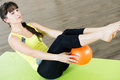 Pretty young girl fitness workout with small ball Stock Photography
