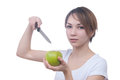 Pretty young girl with green apple and knife this image has attached release Royalty Free Stock Image