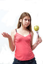 Pretty young girl with a green happy apple Stock Images