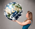 Pretty young girl holding d planet earth Royalty Free Stock Image