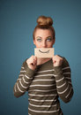 Pretty young girl holding white card with smile drawing Royalty Free Stock Image